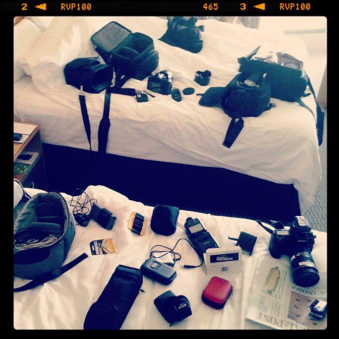 Equipment check. (4 camera bodies, 4 flashes, 8 lenses, dozens of batteries x 4 types, 2 triggers, 2 transceivers, et cetera et cetera.)